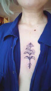 Mint on sternum tattoo design